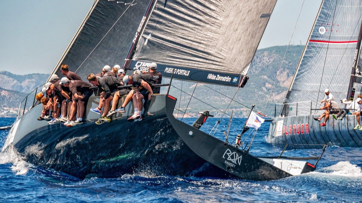 TP 52 yachts RAN and PLATOON racing side by side in the bay of Palma