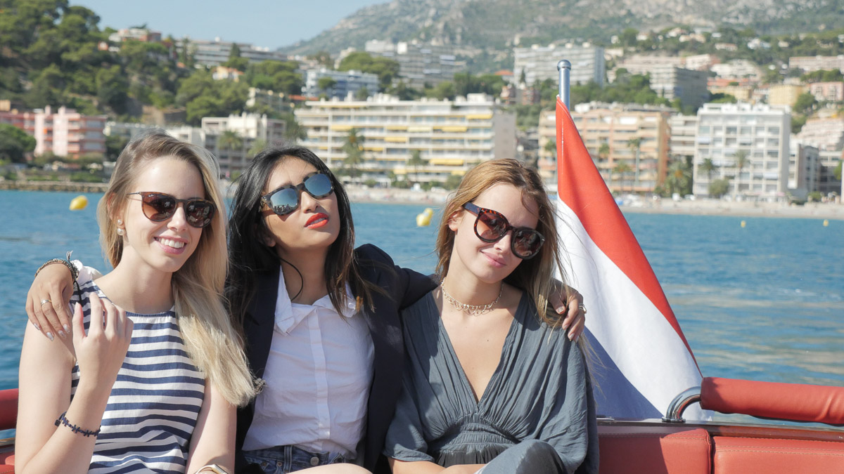 Three fashionable young ladies enjoying a luxury superyacht tender ride off the coast of Monaco